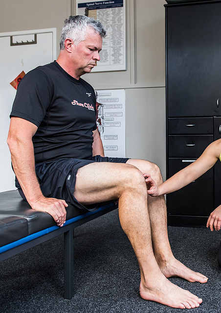Dr Sam with a client at Revolution Chiro | Adults