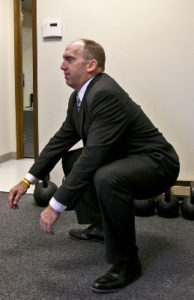 Squats and pushups as easy exercises to perform in the office